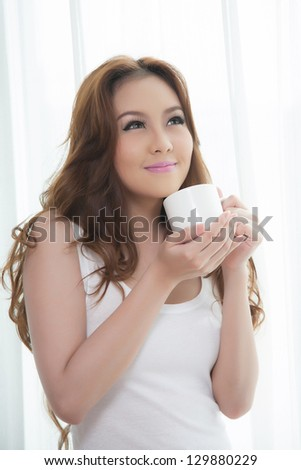 Beautiful asian women drinking coffee - stock photo