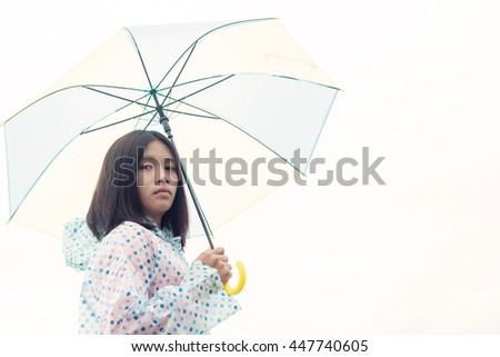 Beautiful asian young girl in the rain with umbrella on white background.