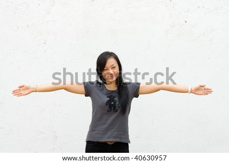 beautiful asian young woman spread her arms wide open - stock photo