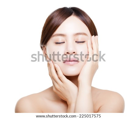 beautiful asian young woman with skin care- isolated on white - stock photo