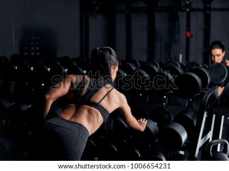beautiful athlete trains in the gym