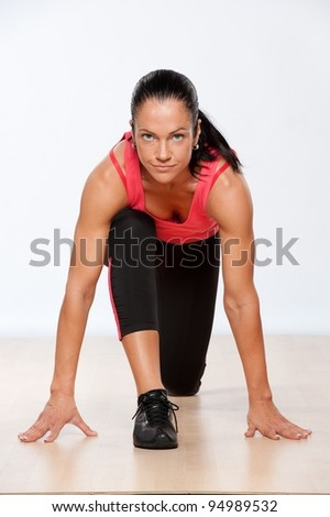 Beautiful athlete woman exercising in fitness club. - stock photo