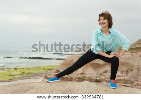 Beautiful athletic woman doing outdoor exercises 