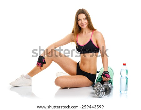 Beautiful athletic woman with dumbbells, mat for fitness, a bottle of water doing sport exercise, isolated on white background - stock photo