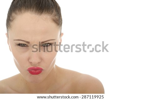 Beautiful Attractive Angry Young Caucasian Woman Looking Threatening and Unhappy Against A White Background - stock photo
