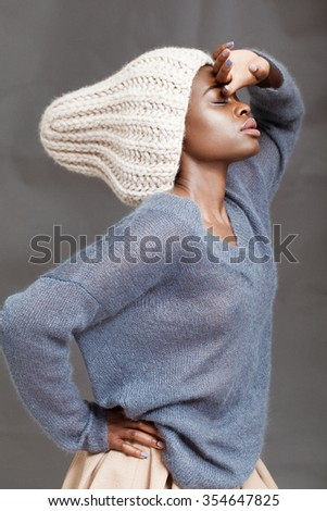 Beautiful attractive black girl in hat posing in the studio.