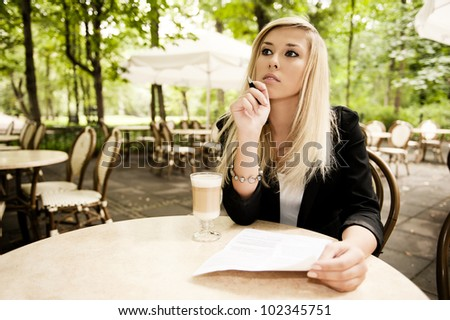 Beautiful attractive blonde writing - stock photo