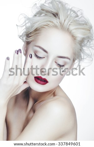 Beautiful attractive charming caucasian woman with perfect white skin and red lips posing in studio white background. - stock photo