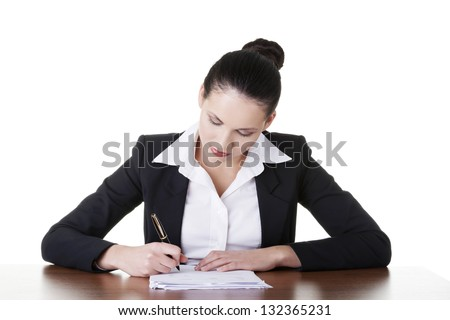 Beautiful attractive corporate lawyer business woman sitting at desk and writing blank paper page, isolated on white background. - stock photo