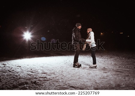 Beautiful, attractive couple on  the ice rink - stock photo