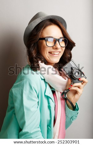 Beautiful attractive girl in a hat with camera. - stock photo