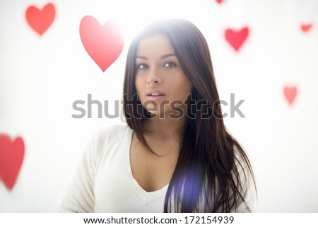 Beautiful attractive girl with hearts - stock photo
