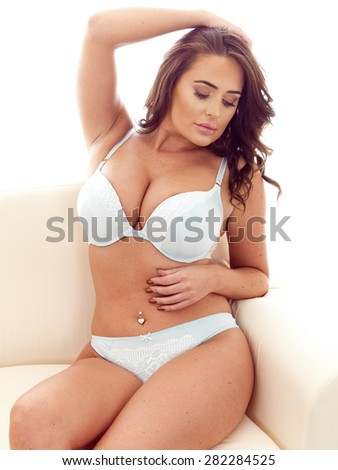 Beautiful Attractive Sexy Young Hispanic Woman Wearing Sensual Seductive Lingerie With Long Dark Hair Against White - stock photo