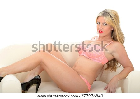 Beautiful Attractive Sexy Young Woman Posing Pin Up in Seductive Feminine Coral Lingerie Against White Background - stock photo