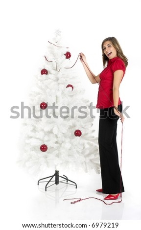 Beautiful attractive woman posing near a white Cristmas tree