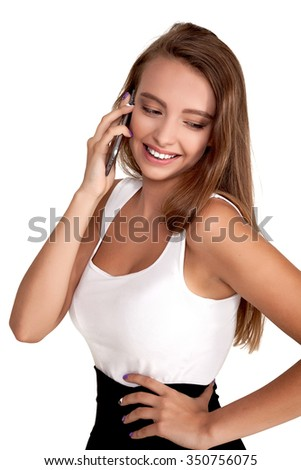 Beautiful Attractive Young Teenage Woman talking on cell phone - stock photo