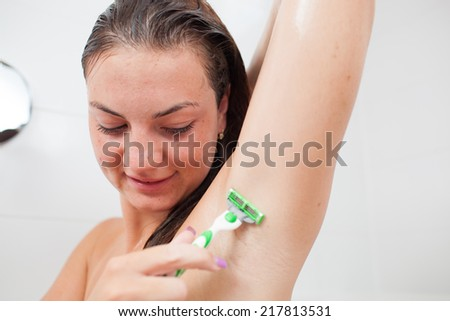 Beautiful/attractive young woman/girl cleaning her teeth/dental hygiene in bathroom  - stock photo