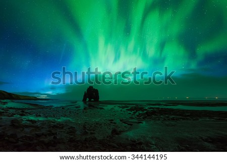 Beautiful Aurora Borealis, Northern light at Hvitserkur, Iceland - stock photo