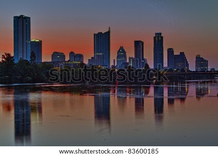 Beautiful Austin skyline reflection on Lady Bird Lake before sunrise - stock photo
