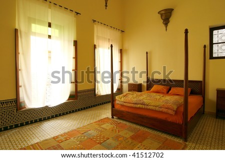 Beautiful authentic arabic bedroom in a traditional Moroccan riad (guesthouse). Fes, Morocco - stock photo