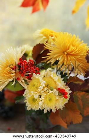 Beautiful autumn bouquet with chrysanthemums flowers, on windowsill - stock photo