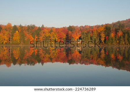 Beautiful autumn landscape highlights the colorful beauty of the changing leaves - stock photo