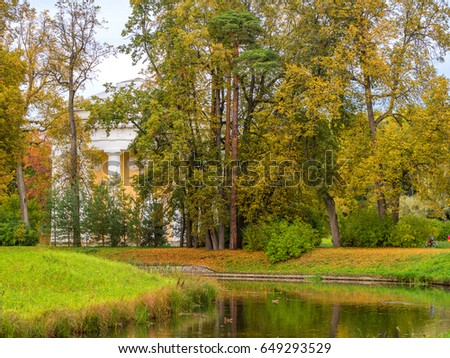 Beautiful autumn landscape in the valley of the Slavyanka river, the distance is the temple of friendship