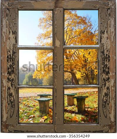 Beautiful autumn landscape through the window - stock photo