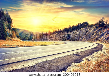 Beautiful autumn landscape with curvy road. Travel concept  - stock photo