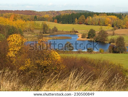 Beautiful autumn landscape with lake - stock photo