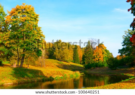 beautiful autumn park at evening before sunset - stock photo