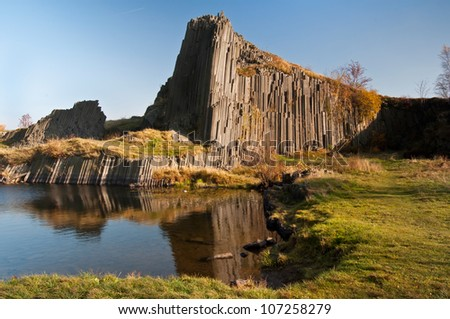 "Beautiful autumn scenery with rocks called ""A manor�´s rock"" and small lakes."