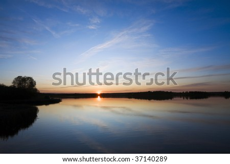 beautiful autumn sunset on lake - stock photo