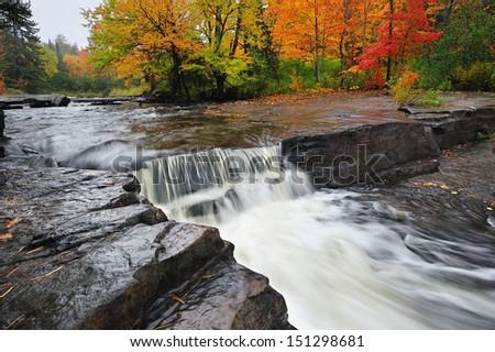 Beautiful Autumn waterfall colors at Canyon Falls , Alberta Michigan  - stock photo
