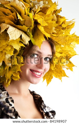 Beautiful autumn women. At the woman an autumn wreath on a head.