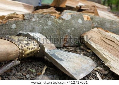 beautiful ax for chopping firewood with wooden handle