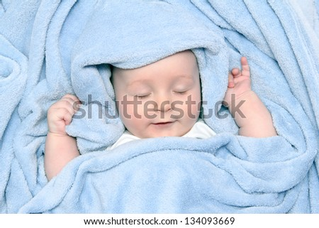 beautiful baby after bath under a blanket - stock photo