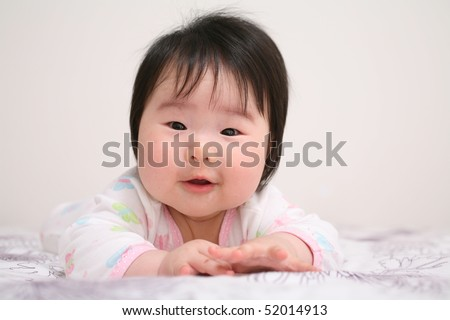 Beautiful Baby Asian Girl Infant Smiling While Crawling - stock photo