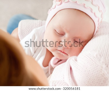 beautiful baby asleep on my mother's hands - stock photo