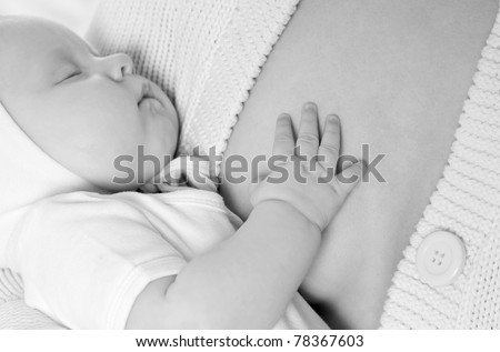 beautiful baby asleep on my mother's hands