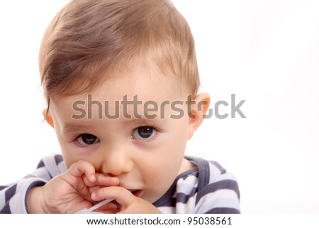 beautiful baby biting, baby studio photo