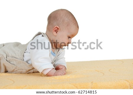 beautiful baby boy on the yellow blanket - stock photo