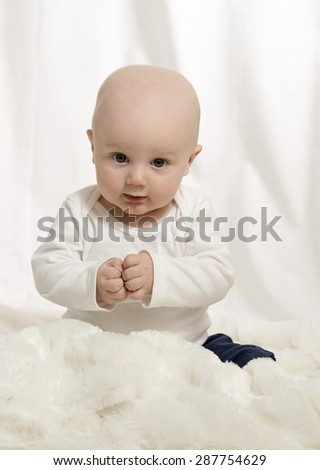 Beautiful Baby Boy with White Background and Furry Blanket - stock photo