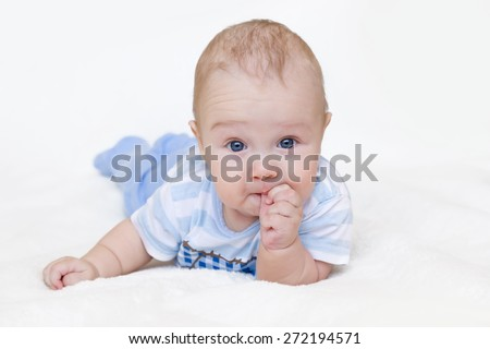 beautiful baby child thumb-sucking on white background, 3 month - stock photo