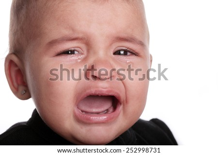beautiful baby crying isolated on white - stock photo