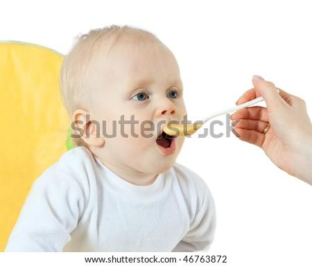 beautiful baby eating - isolated on white background - stock photo