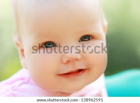 Beautiful baby few months old portrait outdoors