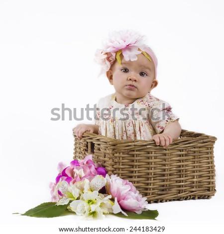 beautiful baby girl in basket - stock photo