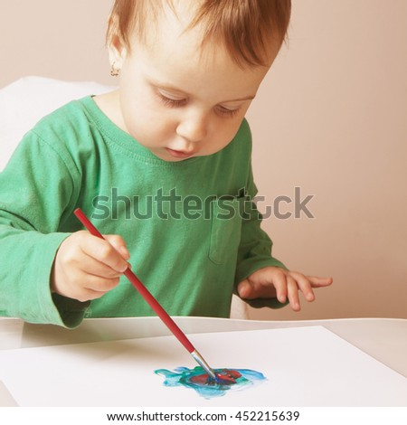 beautiful baby girl learning to draw (training, development, abilities)