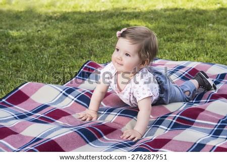 Beautiful baby girl on blanket - stock photo